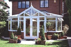 Ultraframe T-shape conservatory by Leekes