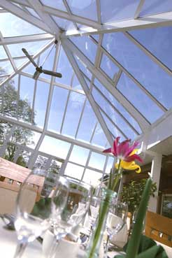 Ultraframe roofed conservatory featuring Conservaglass